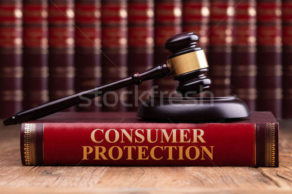 Wooden Gavel And Soundboard On Consumer Protection Law Book Stock photo © AndreyPopov