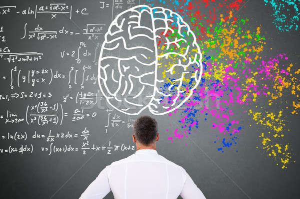 Man Looking At Left Right Brain Diagram Stock photo © AndreyPopov