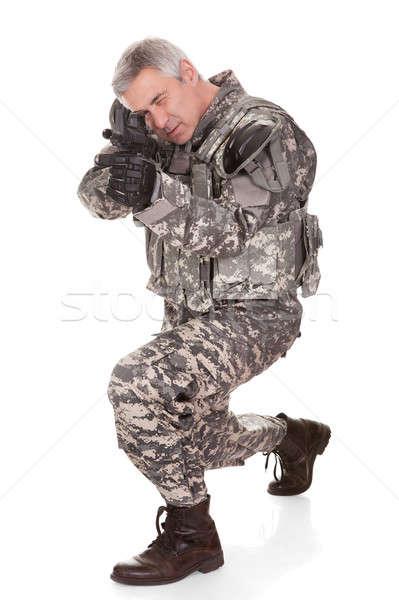 зрелый солдата винтовка изолированный белый фон Сток-фото © AndreyPopov