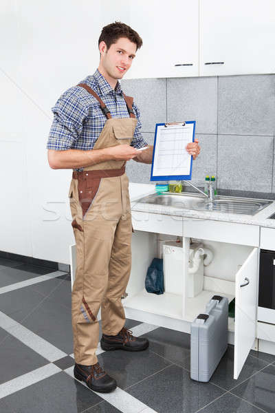 Young Plumber With Clip Board Stock photo © AndreyPopov