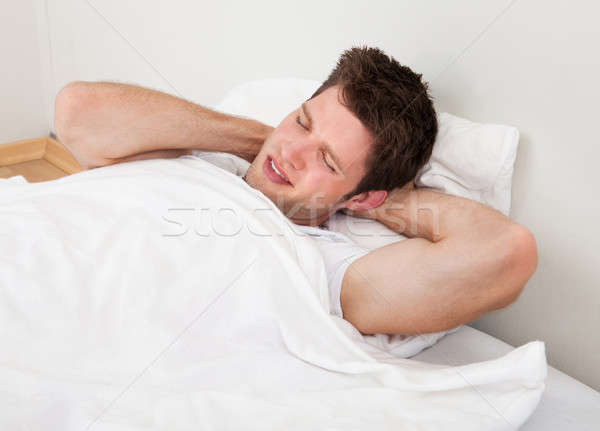 Mann Leiden junger Mann traurig Bett Junge Stock foto © AndreyPopov