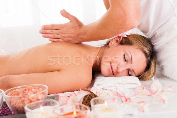 Client relaxing in massage parlor Stock photo © AndreyPopov