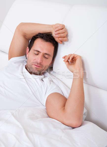 Portré fiatalember alszik ágy hálószoba fal Stock fotó © AndreyPopov