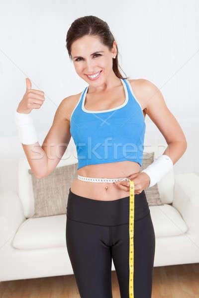 Feliz mujer cintura cinta métrica ver Foto stock © AndreyPopov