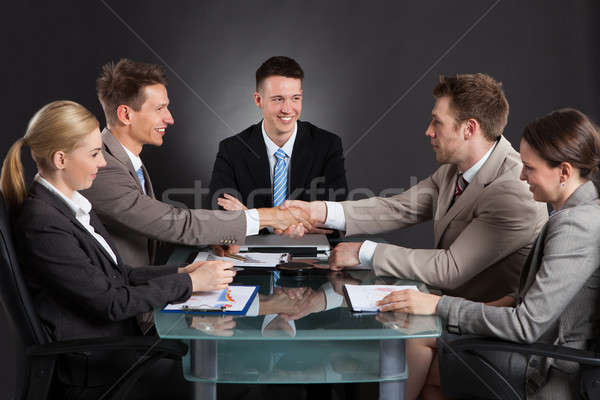 Businessmen Shaking Hands During Conference Meeting Stock photo © AndreyPopov