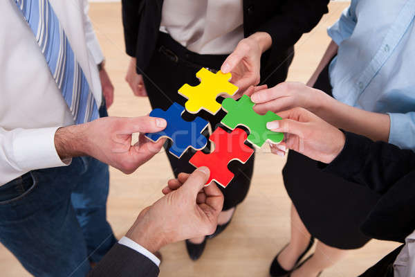 Businesspeople Assembling Jigsaw Puzzle Stock photo © AndreyPopov