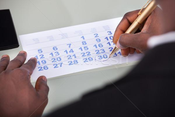 Businessman Marking On Calendar Stock photo © AndreyPopov