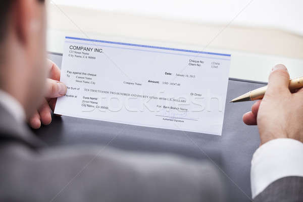 бизнесмен заполнение проверка деньги стороны Сток-фото © AndreyPopov