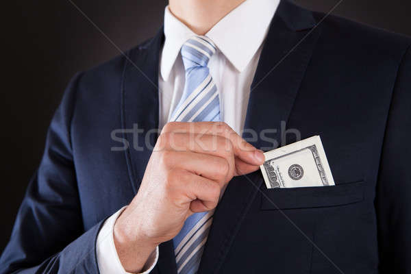 Businessman Putting Money In Pocket Stock photo © AndreyPopov