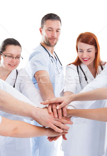 Medical team stacking hands Stock photo © AndreyPopov