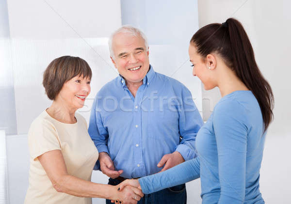 Caregiver Shaking Hands With Senior Couple Stock photo © AndreyPopov