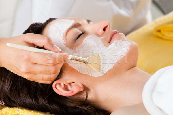 Therapist Applying Face Mask To Customer In Spa Stock photo © AndreyPopov