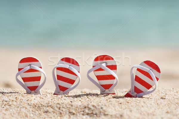 Striped Flip-flops On Beach Stock photo © AndreyPopov