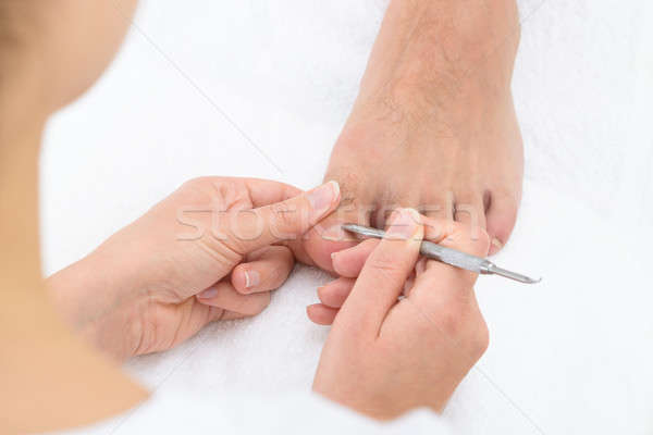 Manicurist Removing Cuticle From The Nail Stock photo © AndreyPopov