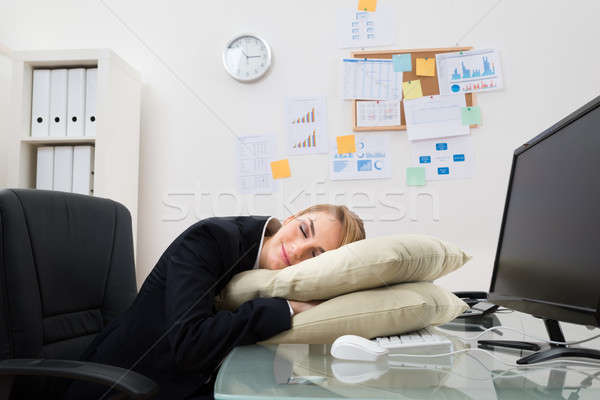 Businesswoman Sleeping In Office Stock photo © AndreyPopov