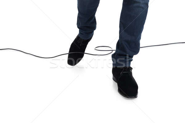 Man Stucked In Cable While Walking Stock photo © AndreyPopov