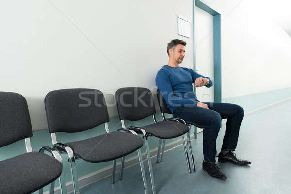 Man Checking Time In Hospital Stock photo © AndreyPopov