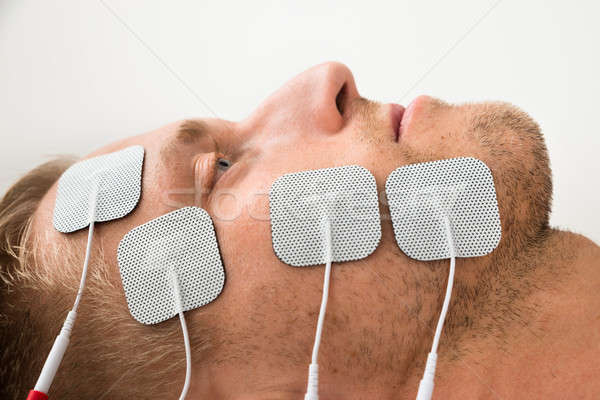 Close-up Of Man With Electrodes On Face Stock photo © AndreyPopov