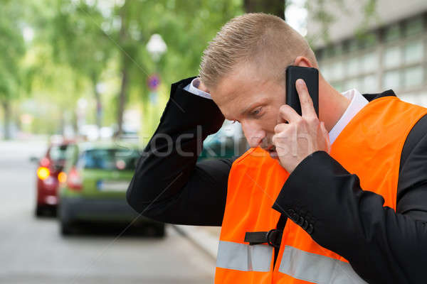 Man Calling On Cellphone After Car Accident Stock photo © AndreyPopov