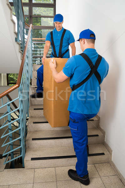 Two Movers Standing With Box On Staircase Stock photo © AndreyPopov