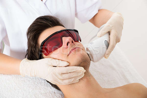 Beautician Giving Laser Epilation Treatment To Man Face Stock photo © AndreyPopov