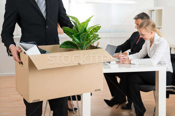 Businessman Carrying Personal Belongings Stock photo © AndreyPopov