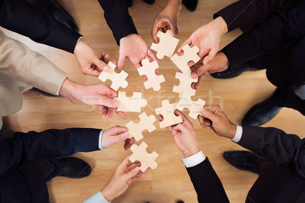 Business Team Joining Jigsaw Pieces Stock photo © AndreyPopov
