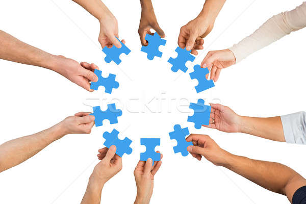 Creative Business People Holding Blue Jigsaw Pieces Stock photo © AndreyPopov