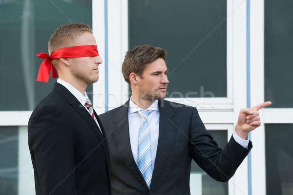 Zakenman geblinddoekt partner jonge buiten kantoor Stockfoto © AndreyPopov