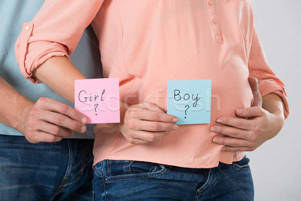 Expecting Couple Holding Paper With Girl And Boy Text Stock photo © AndreyPopov