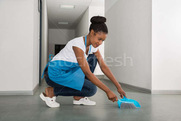 Woman Sweeping Floor With Whisk Broom Stock photo © AndreyPopov