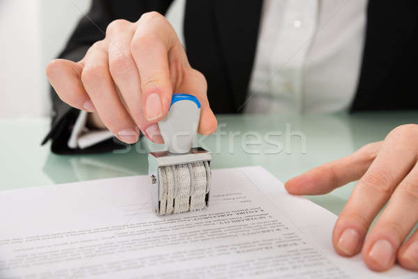 Businesswoman Hand Stamping Paper With Date Stamper Stock photo © AndreyPopov
