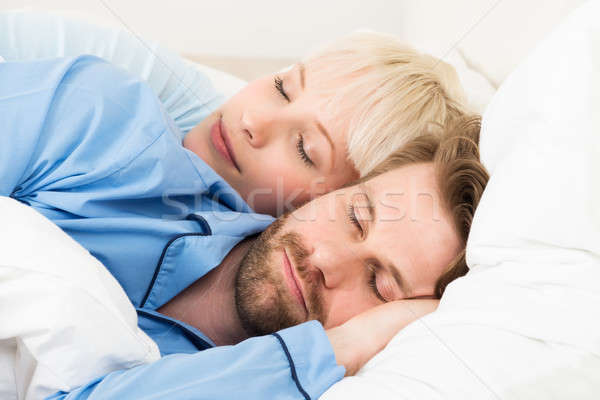 Young Couple Sleeping Together In Bed Stock photo © AndreyPopov