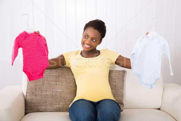 Сток-фото: беременная · женщина · ребенка · одежды · счастливым · сидят