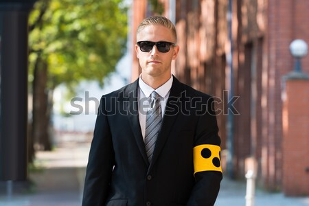 Stock photo: Security Guard Standing Arm Crossed
