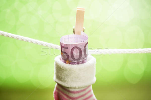 Baby Sock With Dollar Hanging On Rope Stock photo © AndreyPopov