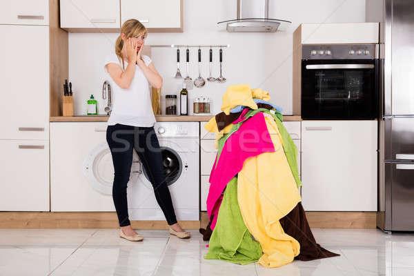 Kimerült nő áll köteg ruházat fiatal nő Stock fotó © AndreyPopov