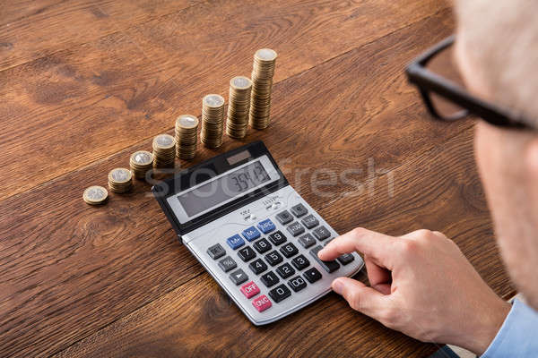 Person Doing Calculation On Saving Stock photo © AndreyPopov