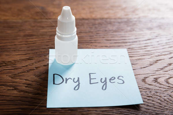 Dry Eyes Concept On Wooden Desk Stock photo © AndreyPopov