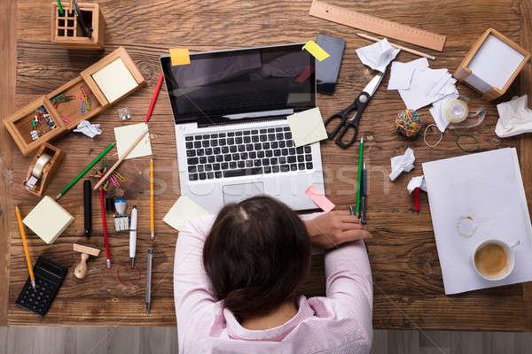 Kimerült üzletasszony munkahely dől asztal laptop Stock fotó © AndreyPopov