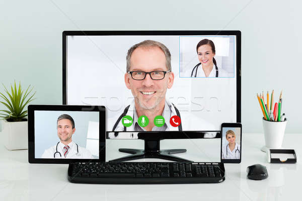 Doctors Having Conference Call At Hospital Stock photo © AndreyPopov