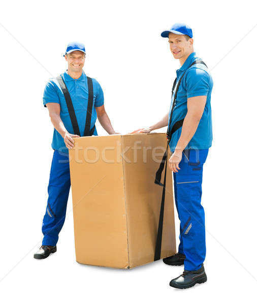 Young Professional Movers With Cardboard Box Stock photo © AndreyPopov