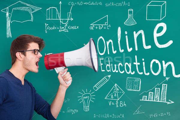 Professor on-line educação megafone masculino Foto stock © AndreyPopov