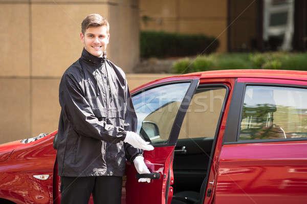 Happy Male Valet Opening Car Door Stock photo © AndreyPopov
