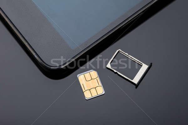 Nano okostelefon közelkép kártya kész asztal Stock fotó © AndreyPopov