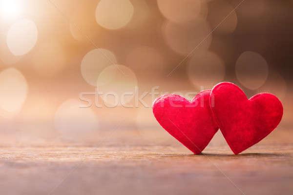 Kettő piros szív fából készült mintázott bokeh Stock fotó © AndreyPopov
