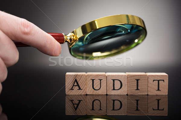 Person Examining Audit Blocks Through Magnifying Glass Stock photo © AndreyPopov