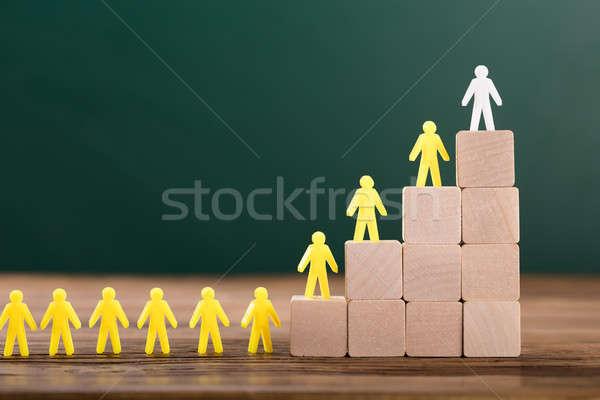 Witte cijfer leidend menselijke top Stockfoto © AndreyPopov