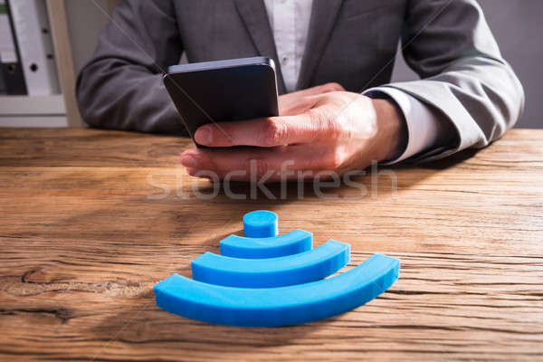 Businessperson's Hand Using Mobile Phone Stock photo © AndreyPopov