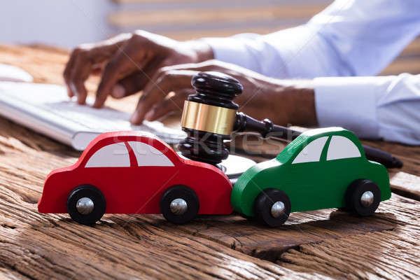 Car With Mallet And Gavel On The Businessman's Desk Stock photo © AndreyPopov